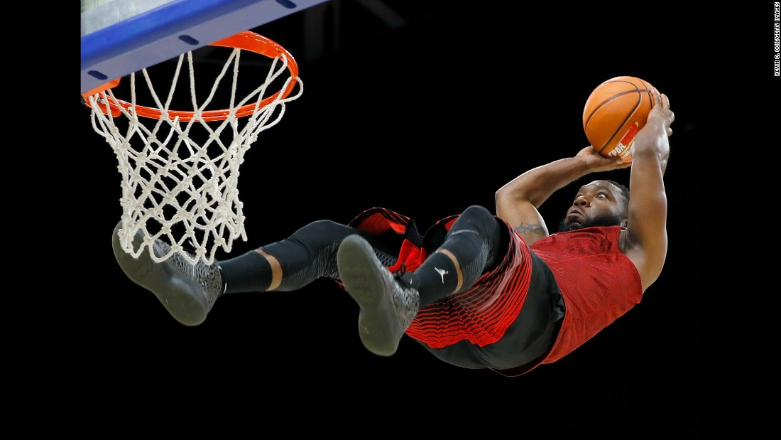 A member of the Air Elite Dunkers, an acrobatic dunk team, performs at a Big 3 basketball event in Lexington, Kentucky, on Sunday, August 6. The team uses trampolines during its act.