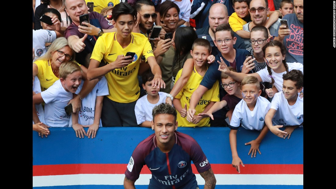 "Brazilian soccer star Neymar poses with fans of Paris Saint-Germain on Saturday, August 5, a day after <a href=""http://www.cnn.com/2017/08/03/football/neymar-barcelona-psg-transfer/index.html"" target=""_blank"">he officially joined the French club</a> for what is the largest transfer fee in world history ($263 million). <a href=""http://www.cnn.com/2017/08/02/football/gallery/neymar-career/index.html"" target=""_blank"">See more photos from his career</a>"