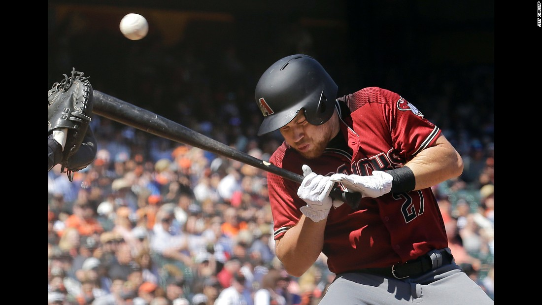 Brandon Drury, pinch-hitting for the Arizona Diamondbacks, takes a pitch off the helmet during a game in San Francisco on Sunday, August 6. He was not hurt.
