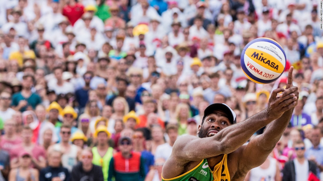 Evandro Goncalves reaches for the ball Sunday, August 6, during the gold-medal match at the Beach Volleyball World Championships. He and Andre Loyola defeated Austrians Clemens Doppler and Alexander Horst.