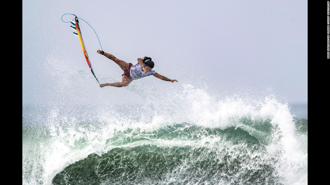 Brazilian surfer Silvana Lima bails off the top of a wave during the US Open of Surfing on Tuesday, August 1.