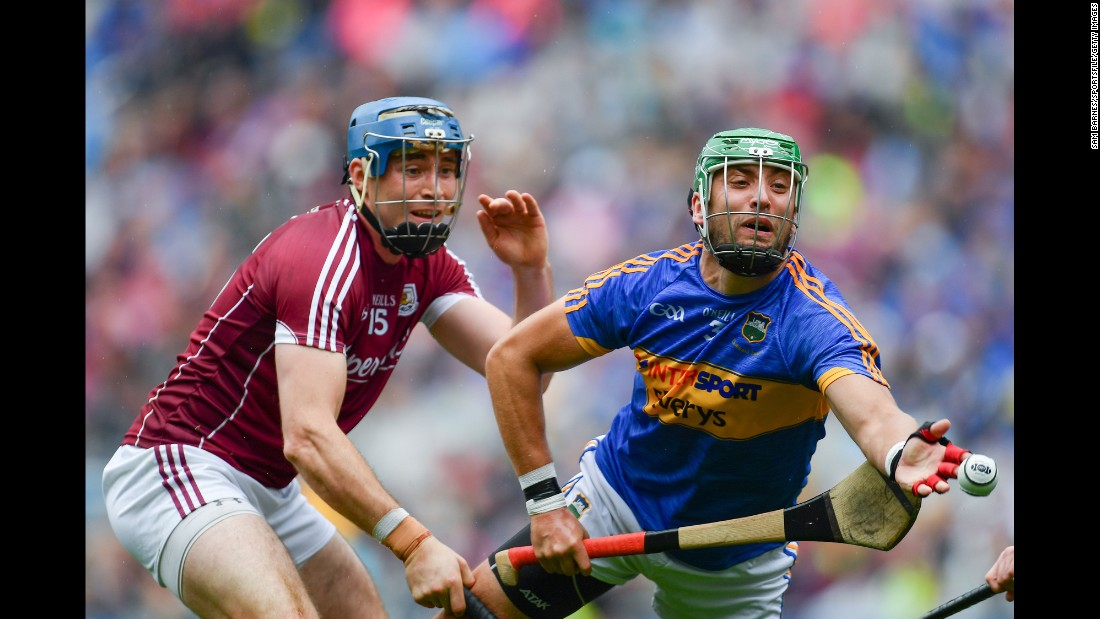 Galway's Conor Cooney, left, competes against Tipperary's James Barry during the semifinals of the All-Ireland Senior Hurling Championship. Galway advanced with a one-point victory on Sunday, August 6.
