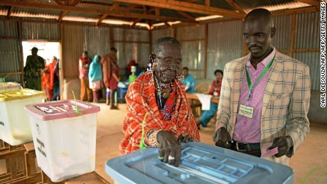 An elderly Maasai lady votes at a polling station in Saikeri, Kajiado West County on August 8, 2017.  Kenyans began voting in general elections headlined by a too-close-to-call battle between incumbent Uhuru Kenyatta and his rival Raila Odinga that has sent tensions soaring in east Africa's richest economy.  / AFP PHOTO / CARL DE SOUZA        (Photo credit should read CARL DE SOUZA/AFP/Getty Images)