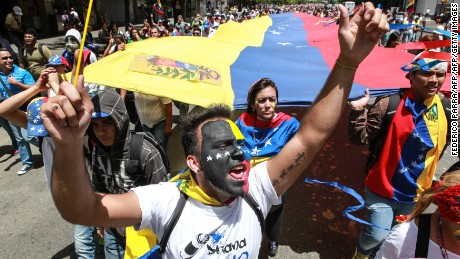 Venezuelan anti-government students shout slogans during a demo in Caracas on June 24, 2014, while the country commemorates the 193rd anniversary of the Carabobo independence battle. AFP PHOTO/ FEDERICO PARRA        (Photo credit should read FEDERICO PARRA/AFP/Getty Images)