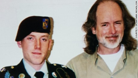 This photo of Nathan Nicholson and his father, Jim Nicholson, was taken during Christmas season of 2003 prior to Nathan's promotion to private first class and prior to his career-ending accident.
