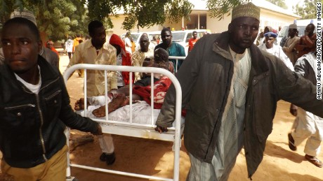 A man injured in a suicide blast in Potiskum, northeastern Nigeria, is transported to a hospital. Four people were killed and 46 injured when two female suicide bombers attacked a mobile phone market on January 11, 2015.