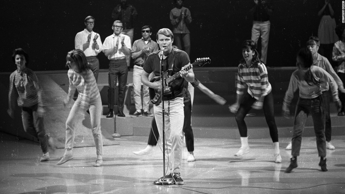 "Campbell rehearses with The Wellingtons and dancers from the TV show ""Shindig!"" in 1965."