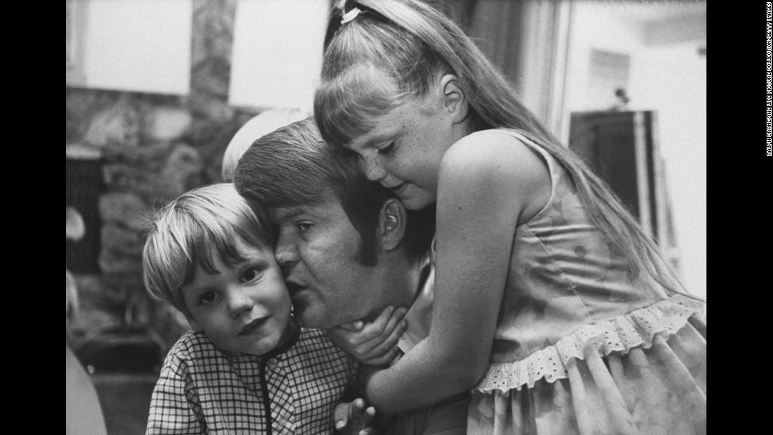 Campbell cuddles with his daughter Kelli and his son Travis in 1968. Campbell was married four times and had eight children.
