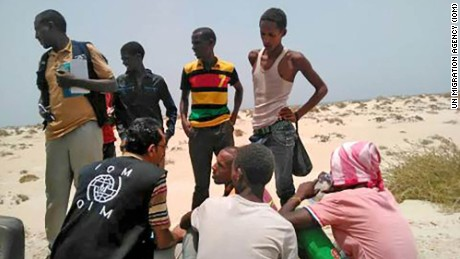IOM staff assist Somali, Ethiopian migrants who were forced into the sea by smugglers on August 9, 2017.