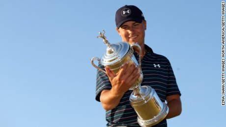 UNIVERSITY PLACE, WA - JUNE 21:  Jordan Spieth of the United States glances at the trophy after winning the 115th U.S. Open Championship at Chambers Bay on June 21, 2015 in University Place, Washington.  (Photo by Ezra Shaw/Getty Images)