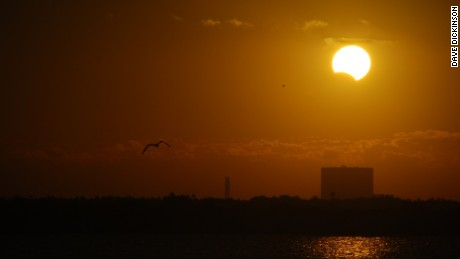 Partial solar eclipse over NASA's Vehicle Assembly Building on November 3rd, 2013