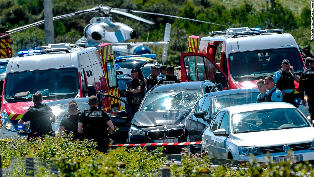 "Police officers and emergency workers stand next to a damaged car near Paris after a driver <a href=""http://www.cnn.com/2017/08/09/europe/paris-soldiers-hit-vehicle/index.html"" target=""_blank"">rammed it into a group of soldiers</a> on Wednesday, August 9. The suspect was shot and arrested after trying to evade police on a highway north of the city. Six soldiers were injured in the attack."