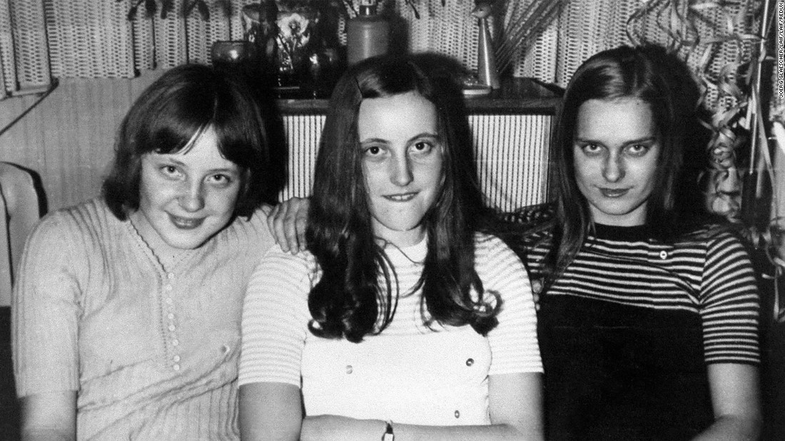 Merkel, left, attends a New Year's Eve party with friends in Berlin in 1972. In 1977, at the age of 23, she married her first husband, Ulrich Merkel. They divorced in 1982, but she kept the name.