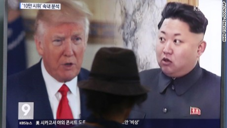 A man watches a television screen showing U.S. President Donald Trump, left, and North Korean leader Kim Jong Un during a news program at the Seoul Train Station in Seoul, South Korea, Thursday, Aug. 10, 2017. North Korea has announced a detailed plan to launch a salvo of ballistic missiles toward the U.S. Pacific territory of Guam, a major military hub and home to U.S. bombers. If carried out, it would be the North's most provocative missile launch to date. (AP Photo/Ahn Young-joon)