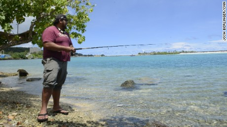 Marco Martinez, 27, fishing in Hagatna.