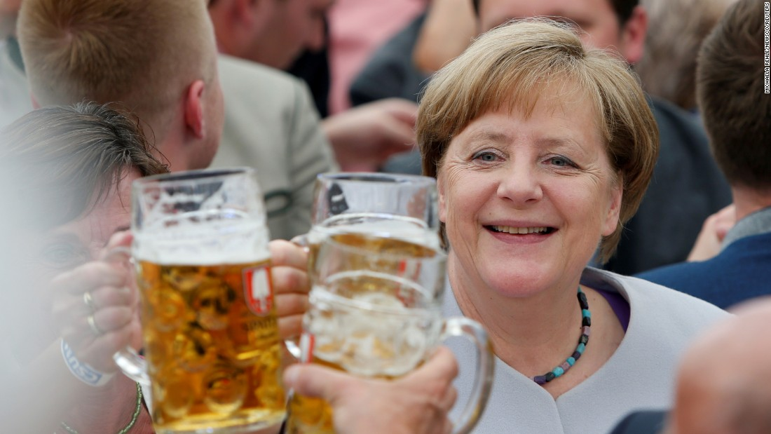 Merkel raises her glass during a toast at the Trudering Festival in Munich, Germany, in May 2017.