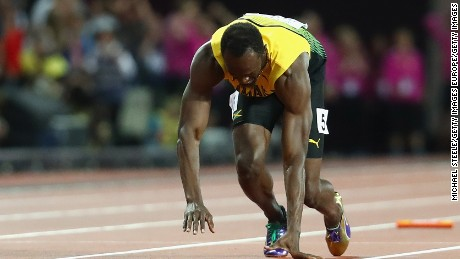 Bolt falls to the track on the final leg of the sprint relay.