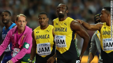 The agony is clear for all to see as Bolt is comforted by Jamaican teammates.