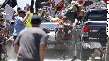 A car plows into counterprotesters marching against white nationalists Saturday in Charlottesville.