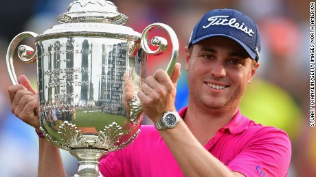 Justin Thomas poses with the Wanamaker Trophy after winning the PGA Championship.