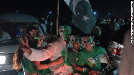 Youths wear masks as they march on a street in Islamabad on August 13, 2017, to mark the country's Independence Day.  Pakistan on August 14 celebrated its 70th anniversary of the country's independence from British rule. / AFP PHOTO / AAMIR QURESHI        (Photo credit should read AAMIR QURESHI/AFP/Getty Images)