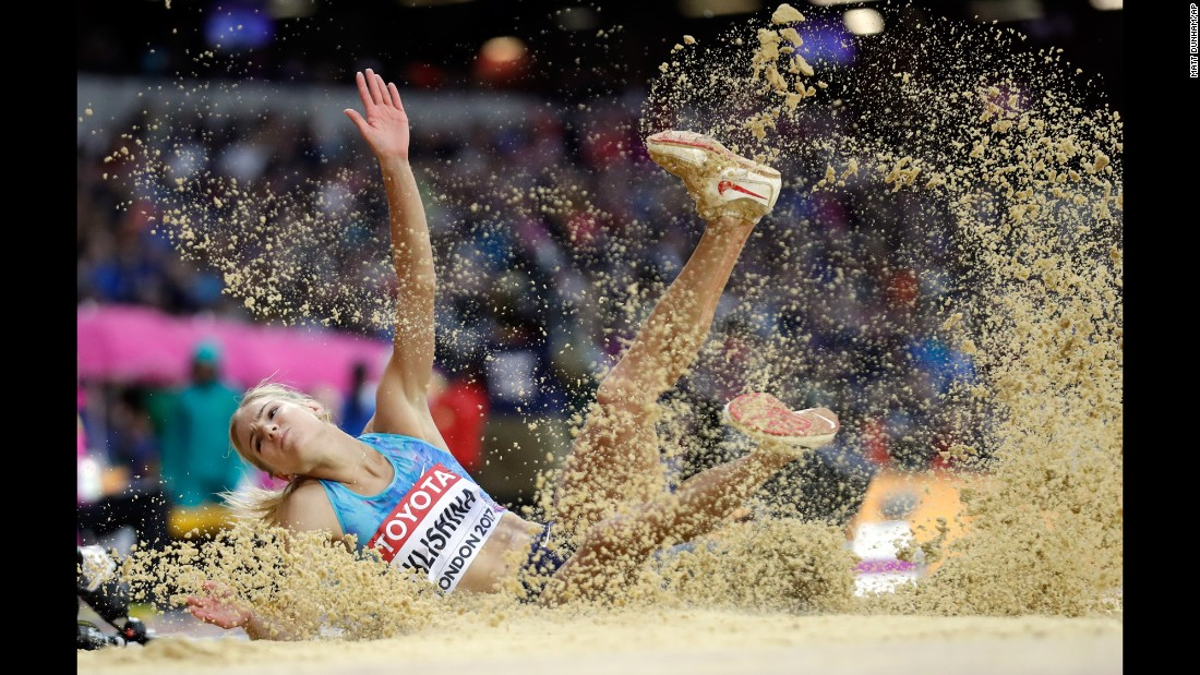 Russian long jumper Darya Klishina lands in the sand pit during the World Championships on Wednesday, August 9. She finished with the silver.