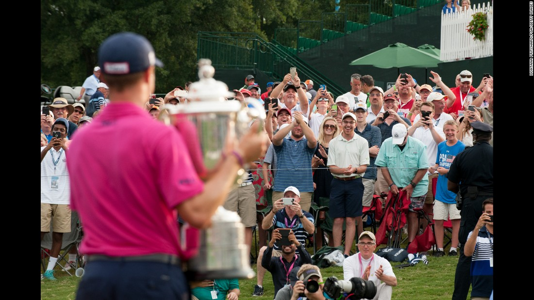 "Golf fans cheer Justin Thomas after <a href=""http://wwww.cnn.com/2017/08/13/golf/pga-championship-thomas-matsuyama-spieth/index.html"" target=""_blank"">he won the PGA Championship</a> in Charlotte, North Carolina, on Sunday, August 13. It was the first major title for Thomas, a 24-year-old American."