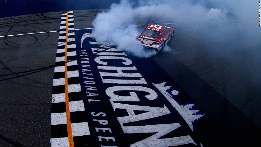 NASCAR driver Kyle Larson celebrates his Cup Series win with a burnout Sunday, August 13, at Michigan International Speedway. He has won three straight races at the track.