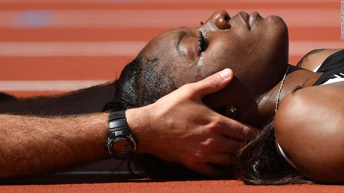 Deborah John, a hurdler from Trinidad and Tobago, receives medical attention Friday, August 11, after she crashed headfirst into a hurdle during a race at the World Championships. She was stretchered away and taken to the hospital, but she was not seriously injured.