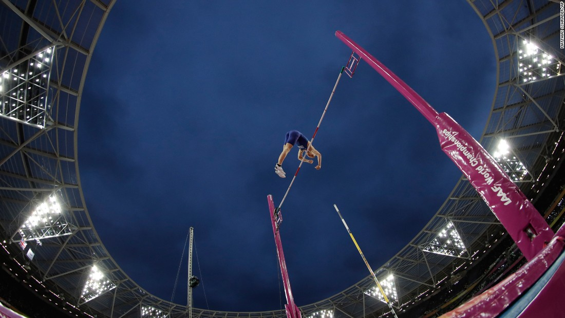American pole vaulter Sam Kendricks finishes a jump on his way to becoming world champion on Tuesday, August 8.
