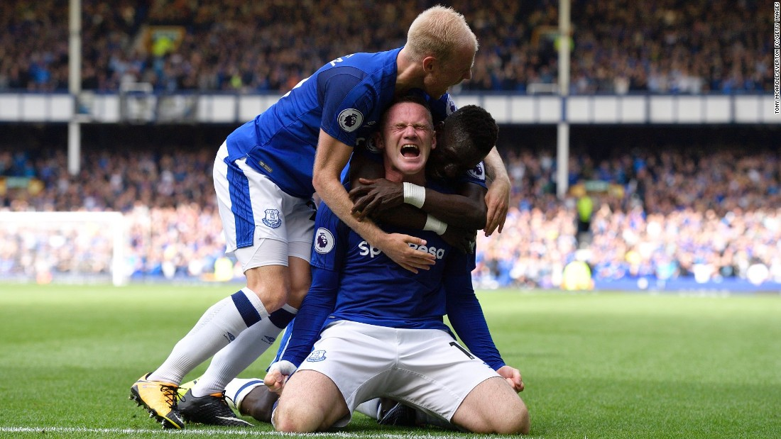 Wayne Rooney is hugged by Everton teammates Davy Klaassen, left, and Idrissa Gueye after scoring a goal against Stoke City on Saturday, August 12. It was Rooney's first Premier League goal since returning to his boyhood club this summer, and Everton held on to win 1-0.