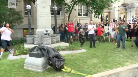 Protesters tear down Confederate monument