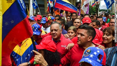 "Venezuelan member of the Constituent Assembly Diosdado Cabello (C) and Venezuelan President Nicolas Maduro's son Nicolas Maduro Guerra (C-R), attend a demo against US President Donald Trump, in Caracas, on August 14, 2017. The United States vowed Monday to stop Venezuela from becoming a ""failed state,"" as it rallied Latin American allies after President Donald Trump warned of possible military action. / AFP PHOTO / RONALDO SCHEMIDT        (Photo credit should read RONALDO SCHEMIDT/AFP/Getty Images)"