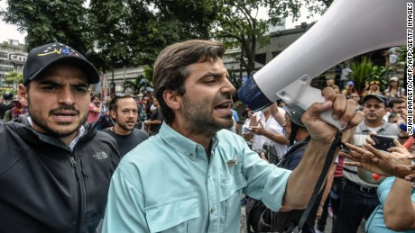 Opposition lawmaker Juan Andres Mejia (C) speaks during a protest against the government of President Nicolas Maduro outside the public Venezuelan Television (VTV) station in Caracas on June 2, 2017.  Maduro offered to hold a referendum on contested constitutional reforms in an apparent bid to calm critics in his own camp as he resists opposition efforts to remove him from office. The opposition says his constitutional reform plan is a bid to cling to power -- and key allies such as Attorney General Ortega have broken ranks with him, arguing it is undemocratic.  / AFP PHOTO / JUAN BARRETO        (Photo credit should read JUAN BARRETO/AFP/Getty Images)