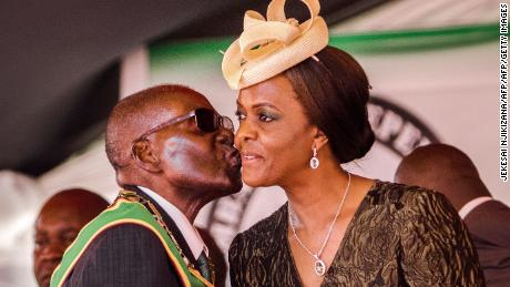 President Robert Mugabe kisses first lady Grace Mugabe during Zimbabwe's 37th Independence Day celebrations in April.