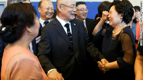 Lim is greeted by members of his congregation at the Light Korean Presbyterian Church.