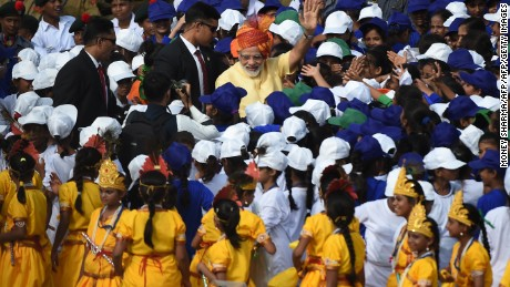 Indian Prime Minister Narendra Modi is surrounded by schoolchildren during 70th anniversary of the end of British colonial rule, at the historic Red Fort in New Delhi.