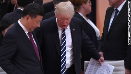 US President Donald Trump (R) and China's President Xi Jinping arrive for a working session on the first day of the G20 summit in Hamburg, northern Germany, on July 7, 2017.  Leaders of the world's top economies gather from July 7 to 8, 2017 in Germany for likely the stormiest G20 summit in years, with disagreements ranging from wars to climate change and global trade. / AFP PHOTO / Patrik STOLLARZ        (Photo credit should read PATRIK STOLLARZ/AFP/Getty Images)