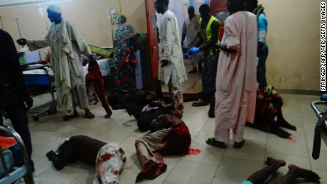 Injured victims of a female suicide bomber lie on the floor awaiting medical attention at a Maiduguri hospital in northeastern Nigeria on August 15, 2017.