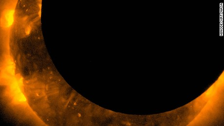 Spectacular images from the Hinode spacecraft show the solar eclipse, which darkened the sky in parts of the Western United States and Southeast Asia yesterday, May 20, 2012. This image shows the maximum eclipse.