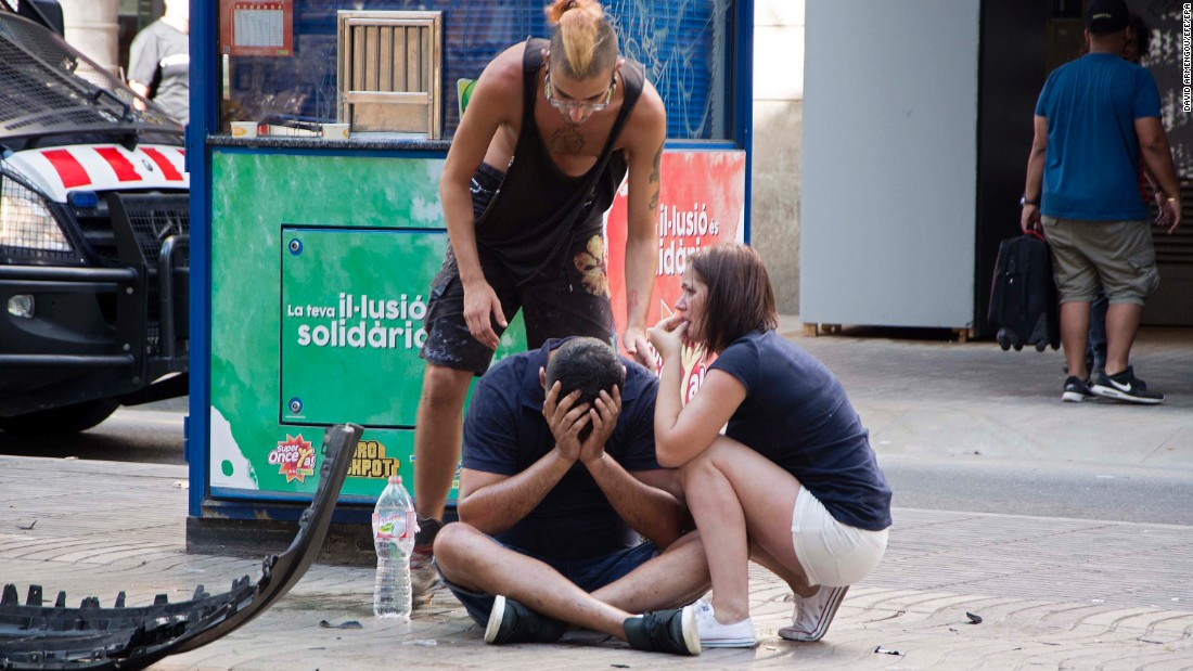 People react after the incident in Barcelona.