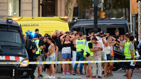 "Policemen check the identity of people standing with their hands up after a van ploughed into the crowd, killing two persons and injuring several others on the Rambla in Barcelona on August 17, 2017. A driver deliberately rammed a van into a crowd on Barcelona's most popular street on August 17, 2017 killing at least two people before fleeing to a nearby bar, police said.  Officers in Spain's second-largest city said the ramming on Las Ramblas was a ""terrorist attack"" and a police source said one suspect had left the scene and was ""holed up in a bar"". The police source said they were hunting for a total of two suspects. / AFP PHOTO / Josep LAGO        (Photo credit should read JOSEP LAGO/AFP/Getty Images)"