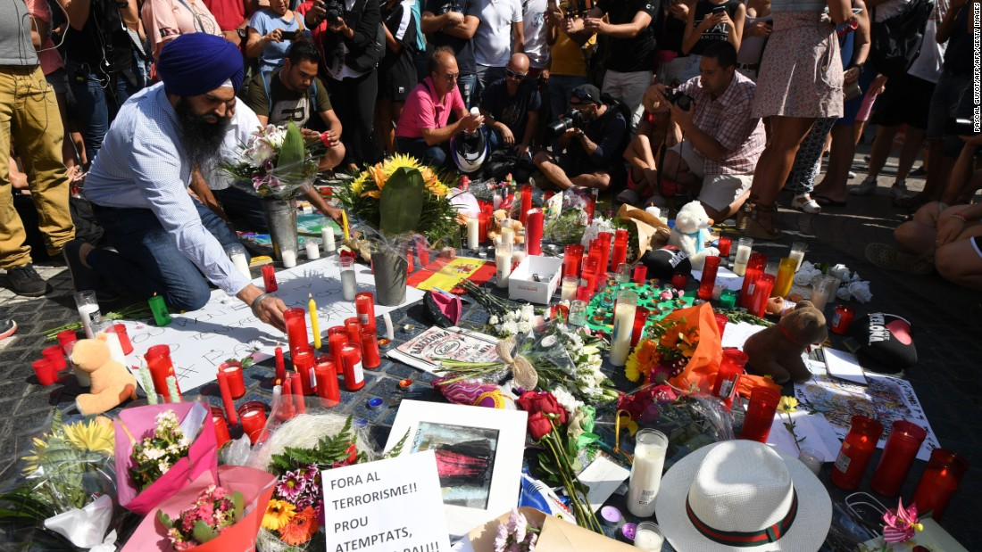 A makeshift memorial pays tribute to those who were killed in a terror attack in Barcelona, Spain, on Thursday, August 17. A van rammed into a crowd of people near the popular tourist area of Las Ramblas. Early the next morning, a group of five attackers drove into pedestrians in the Spanish town of Cambrils, about 75 miles south of Barcelona.