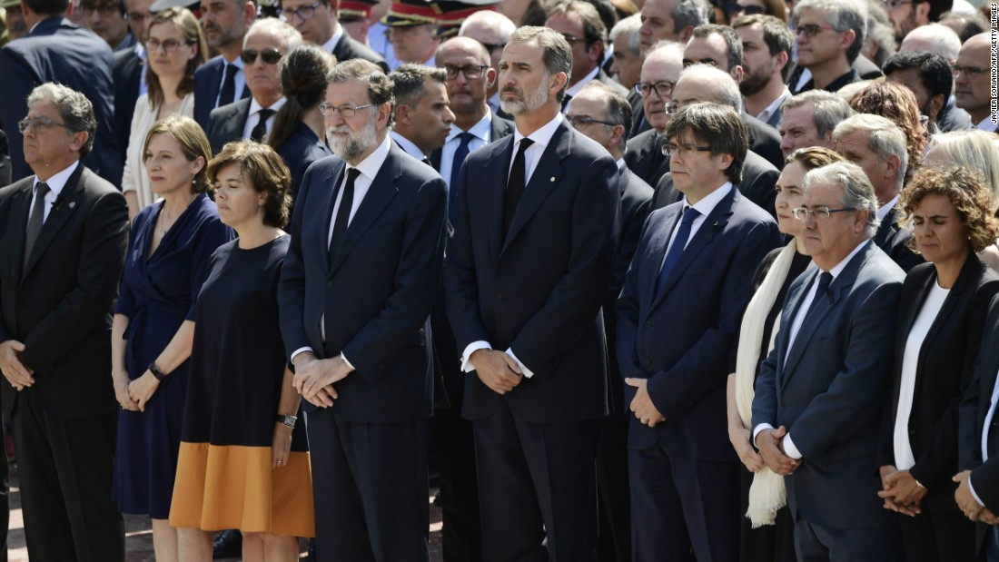 Spain's King Felipe VI joins other officials in observing a minute of silence in Barcelona's Plaça de Catalunya.