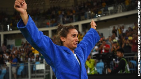 RIO DE JANEIRO, BRAZIL - AUGUST 07:  Majlinda Kelmendi of Kosovo (blue) shows her emotions as she celebrates winning the gold medal against Odette Giuffrida of Italy during the Womens -52kg gold medal final on Day 2 of the Rio 2016 Olympic Games at Carioca Arena 2 on August 7, 2016 in Rio de Janeiro, Brazil.  (Photo by Laurence Griffiths/Getty Images)