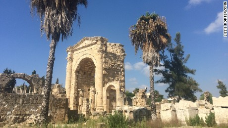 The Triumphal Arch and palm trees at the Al Bass site in Tyre, Lebanon.