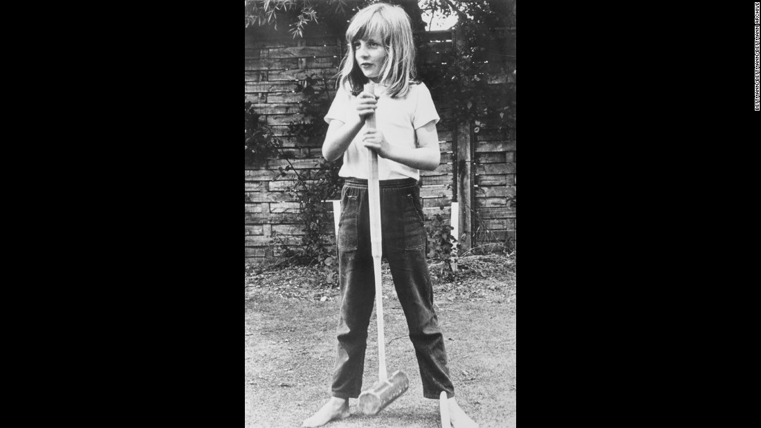 A barefoot Diana poses with a croquet mallet while on holiday in Itchenor, West Sussex, in the summer of 1970.