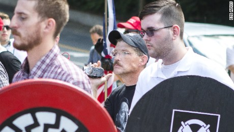 "James Alex Fields, right, at the ""Unite the Right"" rally in Charlottesville, Virginia, on August 12."