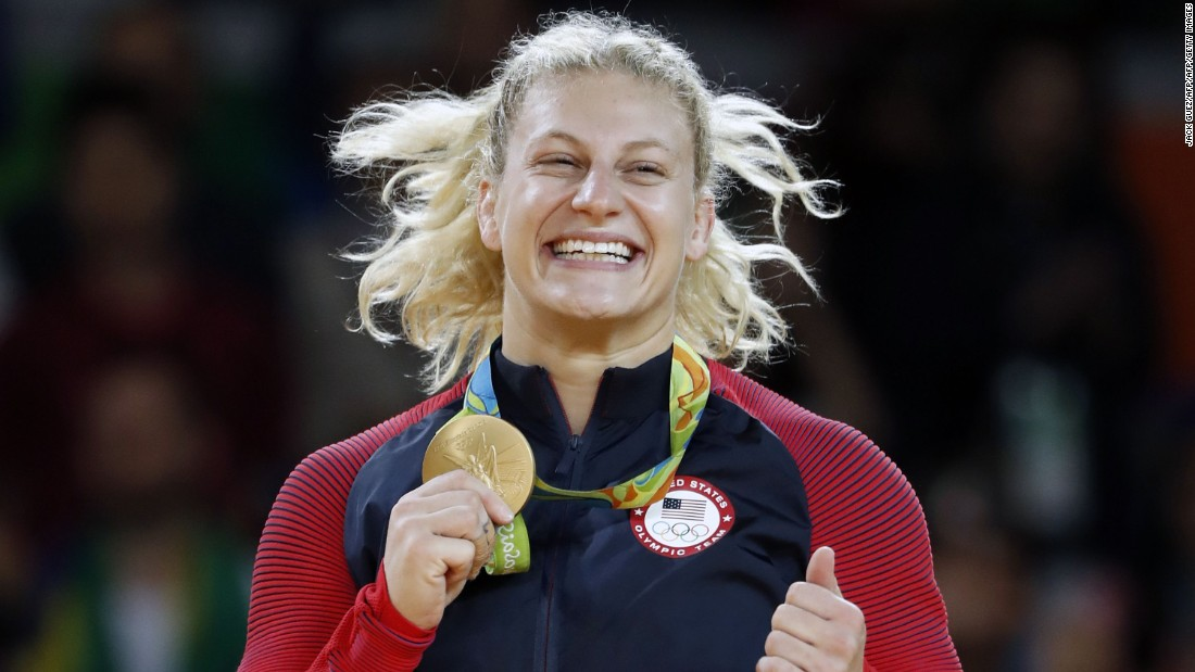 Kayla Harrison celebrates successfully defending her Olympic gold medal at last year's Rio Olympics.