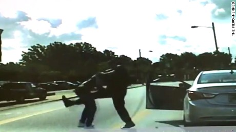 Videos show Ohio officer punching man